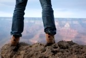 5340079-man-in-hiking-boots-standing-on-edge-of-a-cliff-in-grand-canyon-arizona